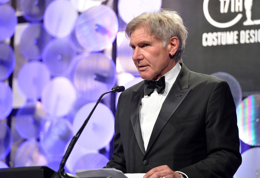 BEVERLY HILLS, CA - FEBRUARY 17: Actor Harrison Ford speaks onstage during 17th Costume Designers Guild Awards with presenting sponsor Lacoste at The Beverly Hilton Hotel on February 17, 2015 in Beverly Hills, California. Photo by Alberto E. Rodriguez/Getty Images for CDG